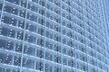 Blank glass facade of curved office building Stock Photo