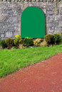 Blank green sign on an old stone wall Royalty Free Stock Images