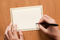 Blank greeting card with hand and pen writing Stock Image