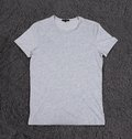 Blank grey tshirt front side on a gray background Stock Photography