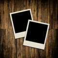 Blank instant photo frames on wooden background Stock Images