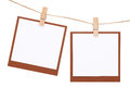 Blank instant photo hung on rope with clothespin Royalty Free Stock Photo
