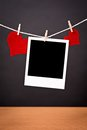 Blank instant photo and two red hearts hanging on the clothesline Stock Photo