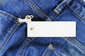 Blank label tag mock-up on jeans. Royalty Free Stock Photo