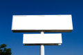 Blank large advertising billboard sign white signs on blue clear sky front view for your advertisement and design Royalty Free Stock Photos