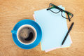 Blank lined paper with coffee office supplies and glasses on wooden table above view Royalty Free Stock Photography