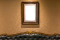 The blank luxury photo frame hanging on wall above the sofa, int Royalty Free Stock Photo