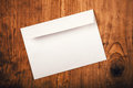 Blank mailing envelope on top of work desk working office as copy space view Stock Image