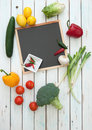 Blank menu empty board surrounded by fresh products and ingredients Royalty Free Stock Photos