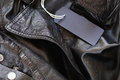 Blank mock-up label tag on leather jacket Royalty Free Stock Photo