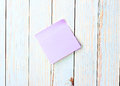 Blank note paper stick poster on wood background Stock Photos