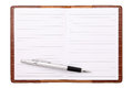 Blank notebook and ballpoint pen isolated on white background Stock Photography