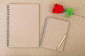 Blank notebook on natural brown paper cover next to wooden pencil and red rose Royalty Free Stock Photo