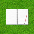 Blank notebook and pencil on Green Grass Stock Photos