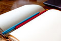 Blank notebook with pencils there are the red and blue on the old table made from wood Royalty Free Stock Photography