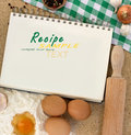 Blank notebook for recipes with baking ingredients Royalty Free Stock Photo