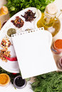 Blank notebook sheet with spices and herbs on the wooden board Royalty Free Stock Photos