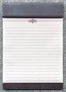 Blank notepad on the brown clipboard for memorandum in meeting room Royalty Free Stock Image