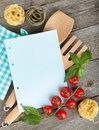 Blank notepad paper for your recipes and food on wooden table Stock Photo