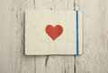 Blank notepad with red heart on wood background Stock Images