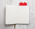 Blank notepad with red heart on wood background Royalty Free Stock Image