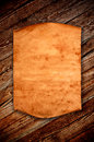 Blank old paper against the background of an aged wood with curled edge Royalty Free Stock Image