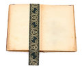 Blank open book with antique ribbon Royalty Free Stock Photo