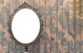 Blank Oval Mirror on vintage wall Royalty Free Stock Photo