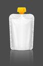 Blank packaging squeeze pouch isolated on gray background Royalty Free Stock Photo