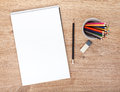 Blank paper and colorful pencils on the wooden table view from above Stock Images