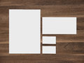 Blank paper, envelope and business cards on wooden Royalty Free Stock Photo