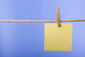Blank paper notes hanging on rope with clothes pins, copy space Royalty Free Stock Photo