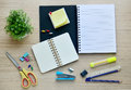 Blank paper and office tools on the wood table - Top view Royalty Free Stock Photo