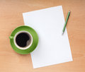 Blank paper pen coffee cup wood table Stock Photo