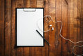 Blank paper, pencil and headphones Royalty Free Stock Photo