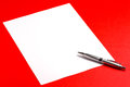 Blank paper sheet silve pen red background Stock Photo