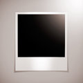 Blank photo frame on a brown wall stock image Stock Image