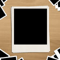 Blank photo frame on brown wooden background with detail Royalty Free Stock Image
