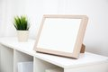 Blank photo frame with copy space on white bookshelf at home Royalty Free Stock Image