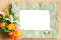 Blank photo frame and pink rose on wooden background. Royalty Free Stock Photo