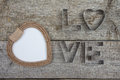 Blank photo frame in shape of heart and inscription love Royalty Free Stock Photo