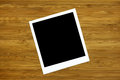 Blank photo frame on wooden background or texture Royalty Free Stock Photo