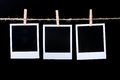 Blank photo frames on line on black Stock Photo