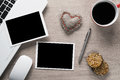Blank photo frames on table laptop with coffee cup photos and pen wooden Stock Image