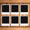 Blank photo frames on wood background Royalty Free Stock Photo