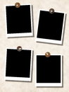 Blank photo templates with push pins on wall Royalty Free Stock Photo
