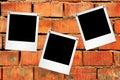 Blank photographs on brick wall background Royalty Free Stock Photo