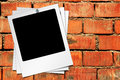 Blank photographs on brick wall background Stock Images