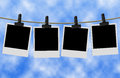 Blank photographs hanging on clothesline Royalty Free Stock Photo