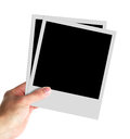 Blank photos in hand isolated on white background Royalty Free Stock Images